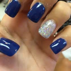 Royal blue acrylic nails with silver hair makeup and