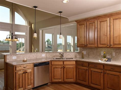 These are the most common, and they work well, bringing out the natural beauty of oak wood. Kitchen Paint Colors with Light Oak Cabinets Ideas Design ...