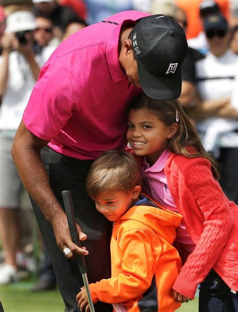 Tiger Woods and his children's colorful clothing make a ...