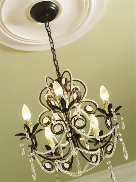 how to add a chandelier to a ceiling fan how to install a decorative ceiling medallion hgtv