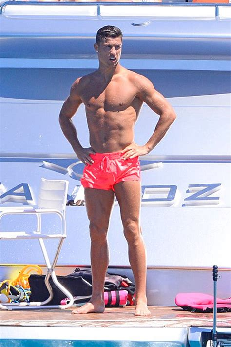 Shirtless Cristiano Ronaldo watches son lark around with