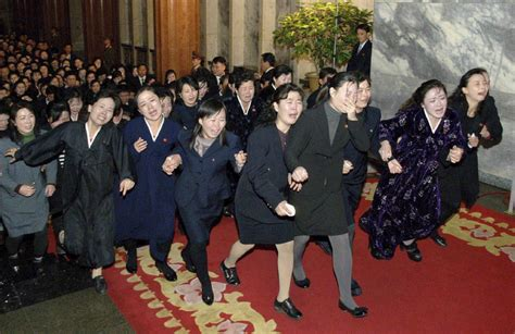 north korea airs footage  wailing mourners  day  kim