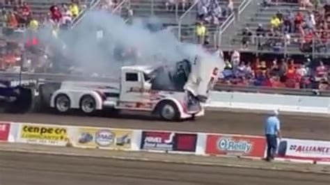 Watch A Semi-truck's Engine Explode Through The Top Of Its