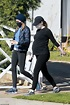 Emma Stone is spotted lovingly cradling her large belly ...