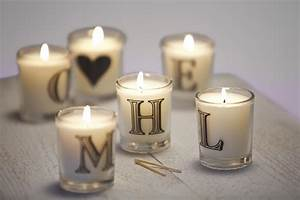 oliver burns preparing the perfect guest bedroom With letter candles