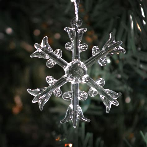 six different clear glass handmade snowflake ornaments