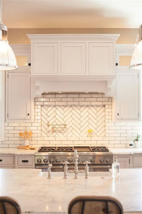 herringbone cooktop backsplash transitional kitchen