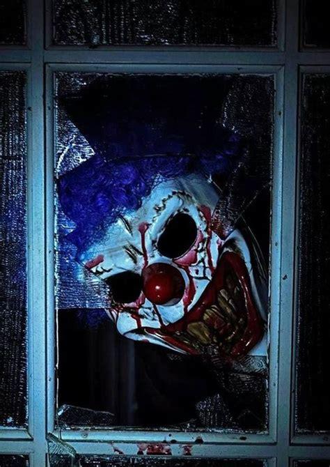 super scary clown halloween   window