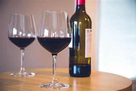 light red wine for beginners two wine glasses with wine bottle on table beginner wine