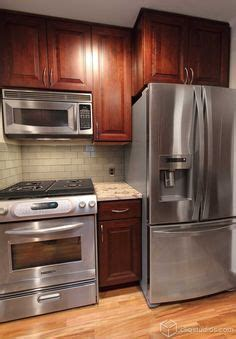 pictures of kitchens with grey cabinets grey hardwood floors accent a modern kitchen with cherry 9121