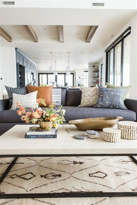 Many coffee tables have an open bottom tier that provides another styling opportunity. New SM Pillows on McGee & Co.!