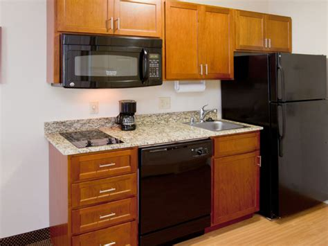 Kitchenette Cabinets by Kitchenette Wood Cabinet With Granite Countertop