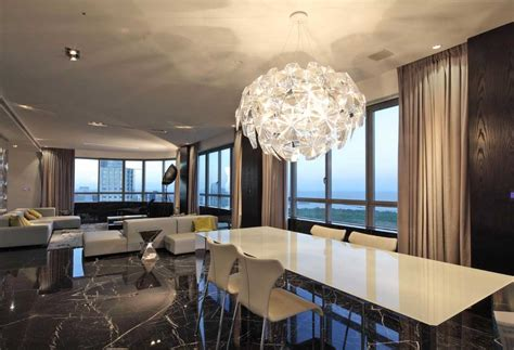 Modern Dining Room Chandelier Over White Dining Table