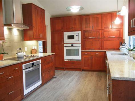 medium brown kitchen cabinets adel medium brown ikea cabinet with white quartz 7421