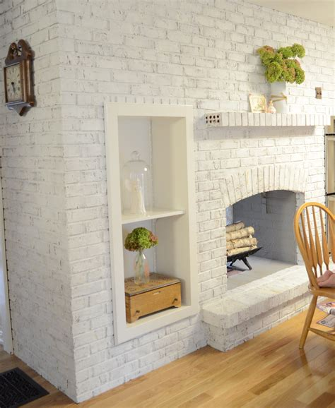 painting brick the crux grey paint wash on a brick fireplace before after
