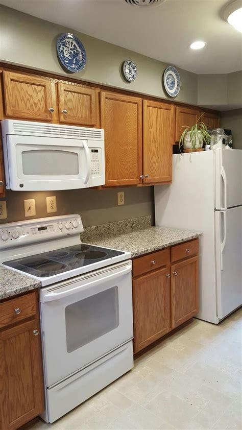 This kitchen designer used a light grey shaker cabinet design for a subtle pop of contrast against the shimmery white herringbone backsplash. Kitchen Wall Colors with Oak Cabinets 12 | Kitchen wall ...