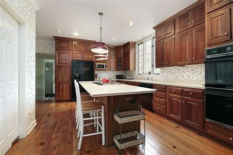 white kitchen island table 43 kitchens with extensive wood throughout