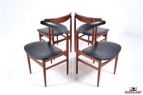 set of four dining chairs in teak room of