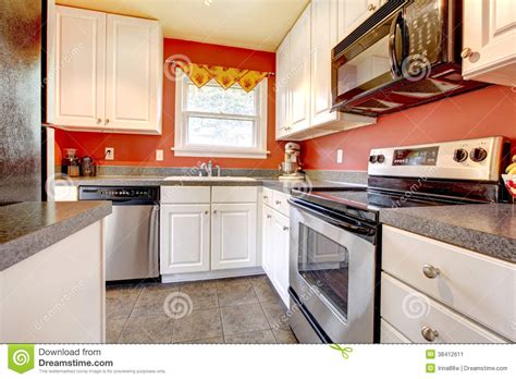 red kitchen walls with white cabinets cozy kitchen room with red wall and white cabinets stock