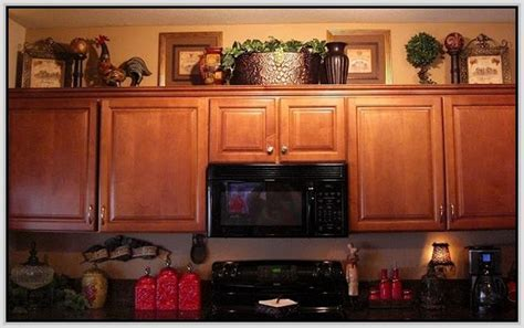 How To Decorate Above Kitchen Cupboards by Decorating Above Cabinets In Kitchen Decorating Above