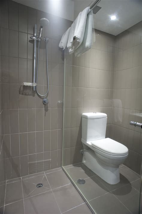 image of toilet and shower in a small bathroom freebie photography