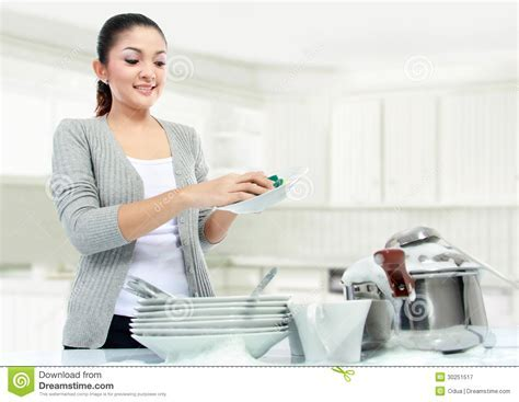 Asian Woman Doing House Work Royalty Free Stock