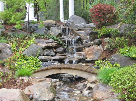 waterfalls and ponds landscaping garden pond and waterfall with bridge in connecticut traditional landscape other metro