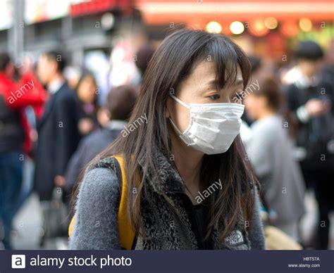 japanese women wearing  surgical face mask stock photo