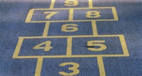 police warn girl   drawing hopscotch grid