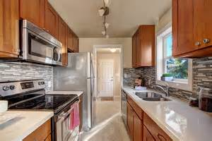 Honey Oak Cabinets with White Quartz Countertops