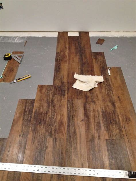laminate wood flooring peeling installing peel and stick laminate floors in a basement remodel by cozy cape cottage basement