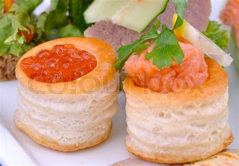 pate canapes canape with salmon caviar and pate of salmon on a plate