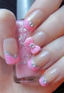 Pretty pink nail design with glitter rhinestones and a