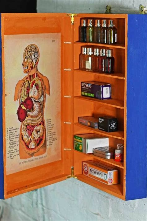 upcycled wine box   medicine cupboard