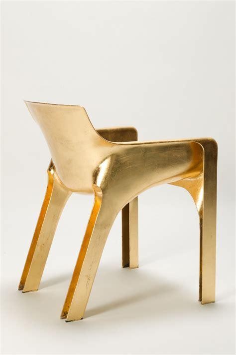 golden gaudi magistretti chair  art