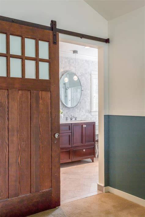 sliding barn door entrance  serene master bathroom hgtv
