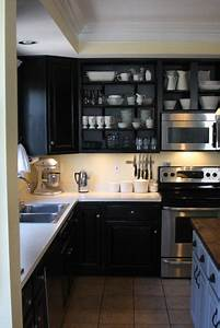 black kitchen cabinets transitional kitchen behr With best brand of paint for kitchen cabinets with silver wall art decor
