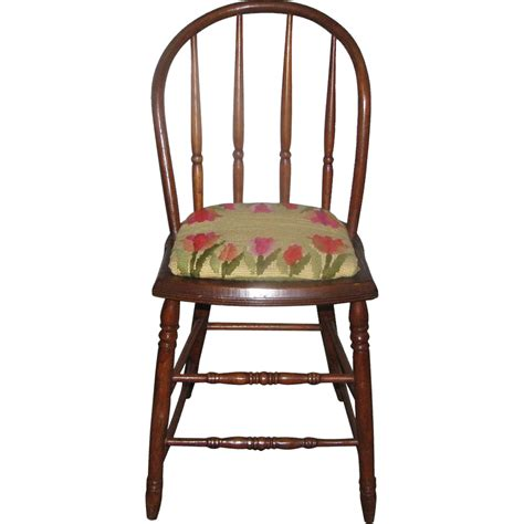 vintage bentwood chairs with needlepoint floral cushion