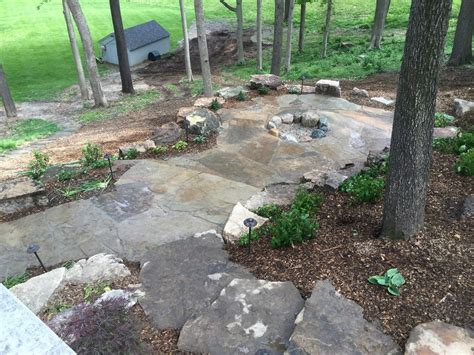wooded garden ideas natural rock landscape design on a sloped and wooded backyard creative outdoor living fishers