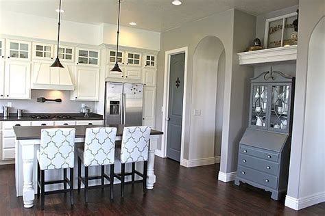 white cabinets gray walls great pattern on the bar stools and gorgeous grey and