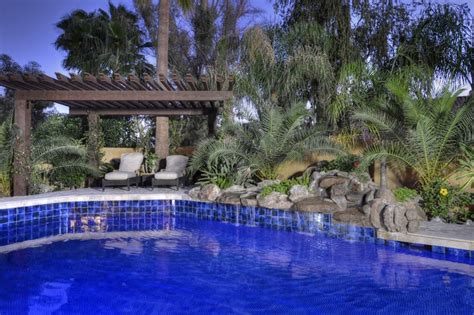 custom blue tile pool with rock waterfall scottsdale