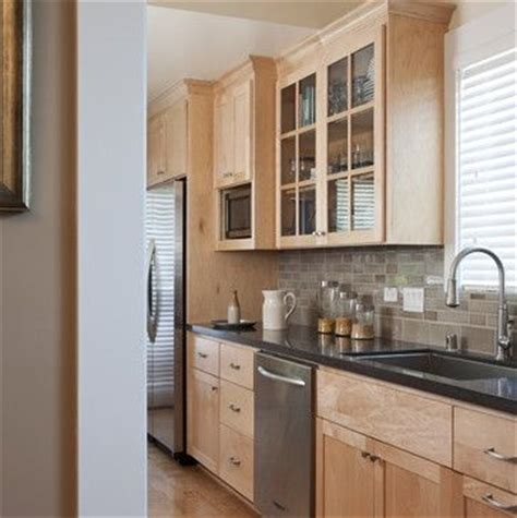 maple kitchen cabinets with quartz countertops like the backsplash with these natural maple cabinets