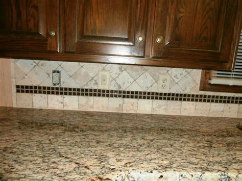 st cecilia granite  dark cabinets traditional