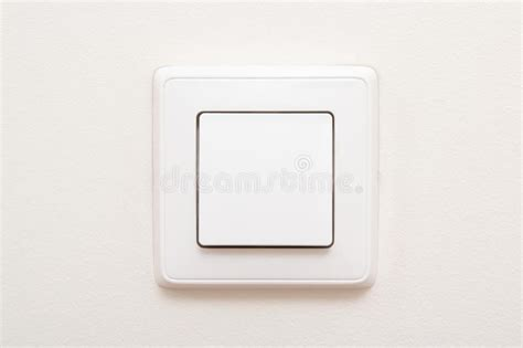 modern light switch on white wall stock photo image