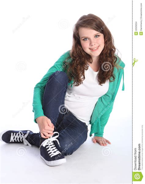 Cute Teenage Girl With Blue Eyes Sits On Floor Stock