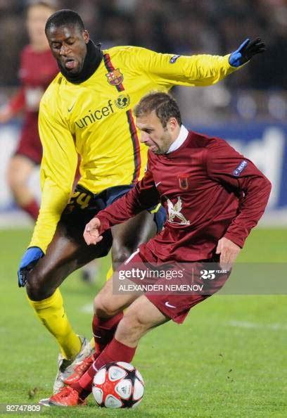 Yaya Toure of FC Barcelona vies with Gokdeniz Karadeniz of ...