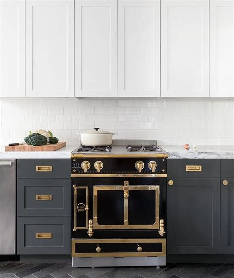 gold  black french stove  hidden vent hood