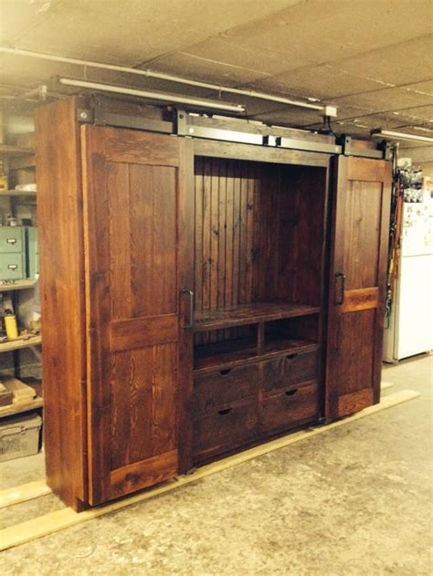 entertainment cabinet with doors 13 best images about barn door entertainment cabinet on