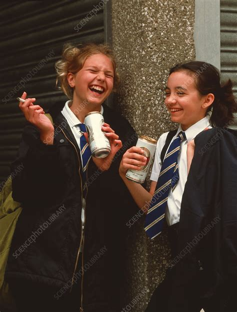young teenage girls smoke  drink beer outdoors stock