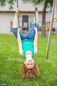 Girl, Upside, Down, On, Swing, Looking, At, Camera, Stock, Photo